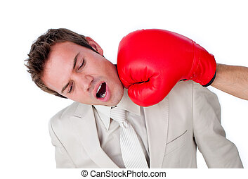Close-up of a businessman being hit with a boxing glove...