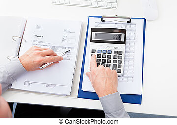 Businessman Calculating Finance - Close-up Of A Businessman...