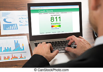 Businessman Checking Credit Score - Close-up Of A...