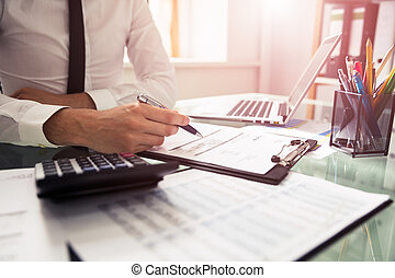Businessman Checking Invoice
