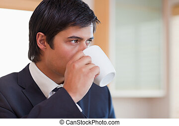 Close up of a businessman drinking tea