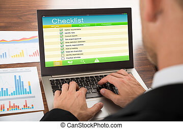 Businessman Filling Checklist Form