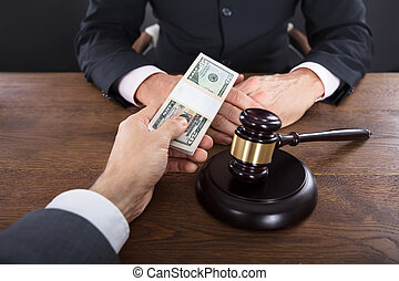 Businessman Giving A Bribe To A Judge