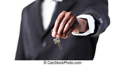 Close-up of a businessman holding a key