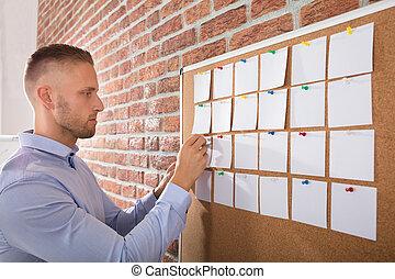 Businessman Looking At Notes