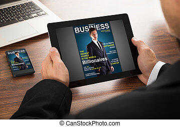 Businessman Reading Online Magazine