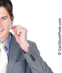 Close-up of a businessman talking on a headset