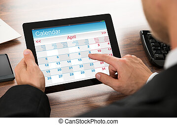Businessman Using Calendar On Digital Tablet