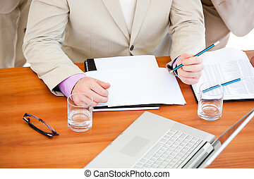 Close-up of a businessman working in a meeting