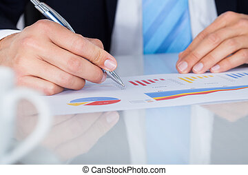 Businessman Writing On Graph