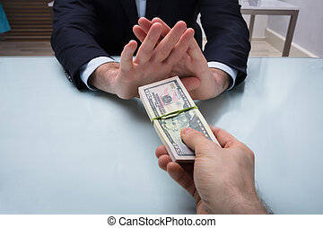 Close-up Of A Businessman's Hand Refusing Bribe
