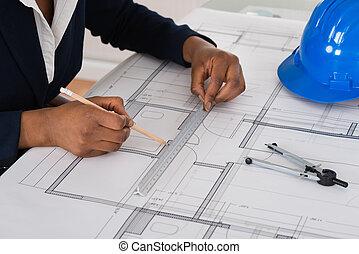 Businesswoman Drawing Blueprint
