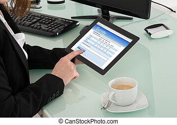 Businesswoman Filling Online Survey Form On Digital Tablet