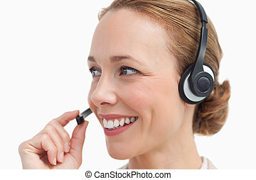 Close-up of a businesswoman talking with a headset