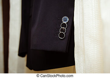 Close up of a button on a striped business suit coat