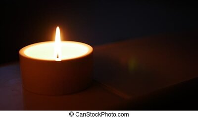 Close-up of a candle, shallow depth of field. - Close-up of...