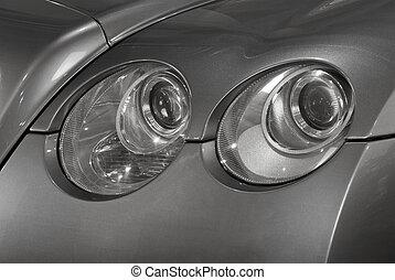 Close up of a car headlights.