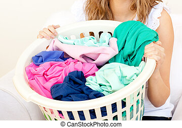 Close-up of a caucasian woman doing laundry against a white...