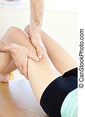 Close-up of a caucasian woman receiving a leg massage