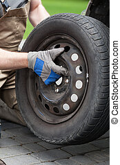 Close-up of a changing a car wheel