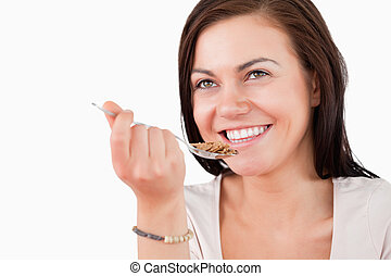 Close up of a charming woman eating cereal