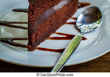 close up of a chocolate cake in white plate