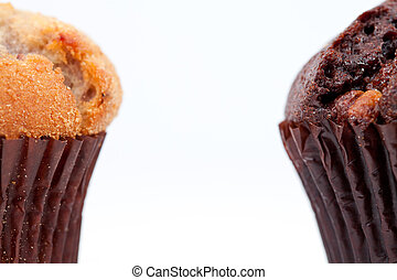 Close up of a chocolate muffin and a regular muffin against ...