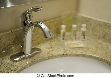 bathroom faucet - Close-up of a chrome bathroom faucet and ...