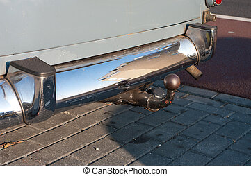 bumper and hitch - close-up of a chrome bumper and hitch of...
