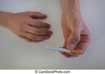 Close-up of a cigarette held in the hands