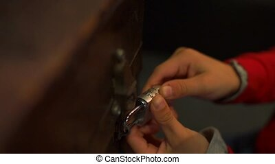Close-up of a combination lock on a chest. They are trying to open the chest.