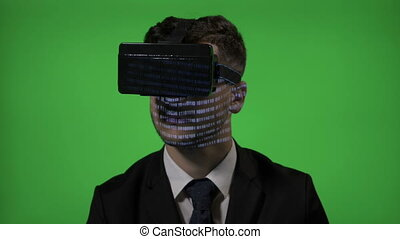 Close up of a computer programmer man dressed in suit coding on vr augmented reality glasses on green screen