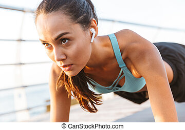 Close up of a concentrated asian sportswoman