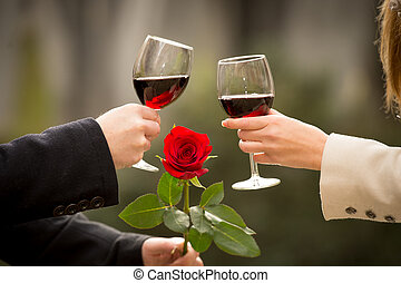 close up of a couple drinking wine on valentines day