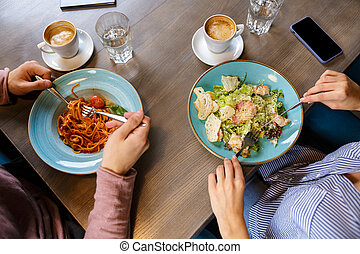 Close up of a couple having lunch over cafe table