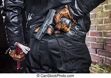 close-up of a criminal with a gun