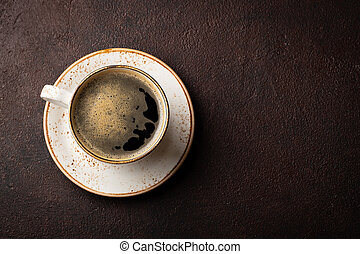 Close-up of a Cup of black coffee on a dark background. Top view with copy space. Flat lay