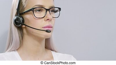 Close-up of a customer service or support representative with headset