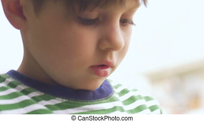 Close up of a cute boy learning and asking questions in slow...