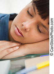 Close-up of a cute student sleeping