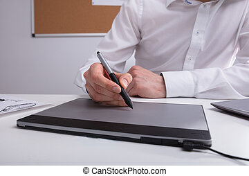 Close-up Of A Designer Using Graphic Tablet