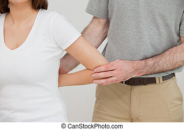 Close-up of a doctor examining the arm of a patient