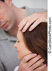 Close-up of a doctor examining the neck of a patient