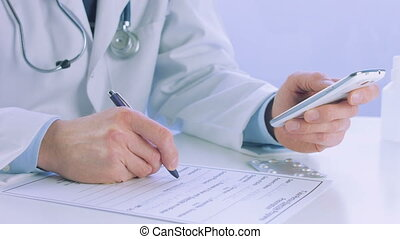 Close up of a doctor hand holding and using a smart phone