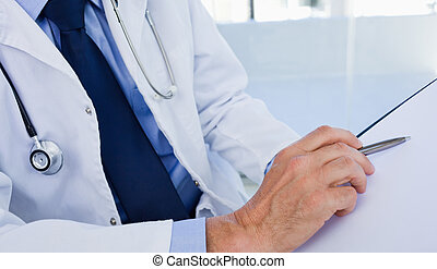 Close up of a doctor showing a document