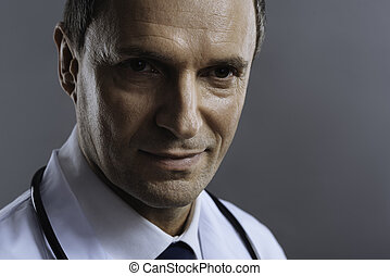 Close up of a doctor standing on grey background