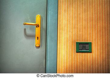 close up of a door handle in a hotel room