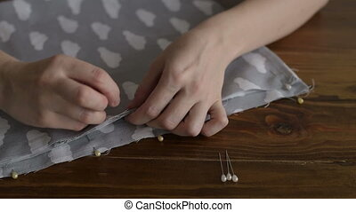 Close up of a dressmaker's hands working