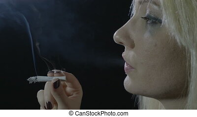Close up of a drug addicted divorced single mother smoking...
