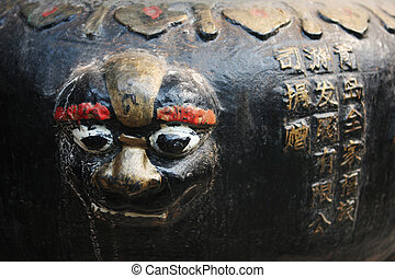 Close-up of a face sculpture at a temple in China